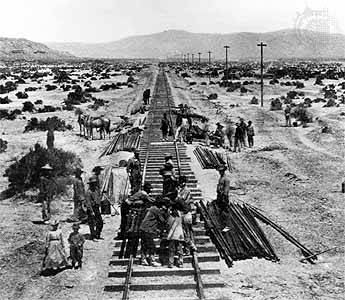 Asian American laborers on the Central Pacific Railroad forge the rail link across the continent in 1869.