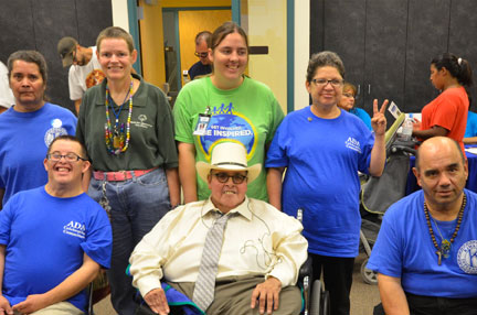 State Representative Phillip M. Archuleta (D-36) joins disabled constituents to celebrate the 24th Anniversary of of ADA at the Doña Ana County ADA Job Fair, held in Las Cruces on Thursday. Representative Archuleta, who is disabled, is seeking re-election this November.
